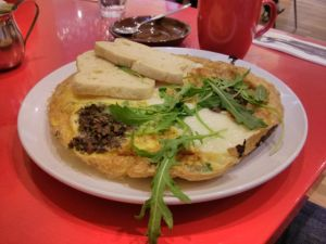 An omelette with mushrooms, goats cheese, rocket and toast