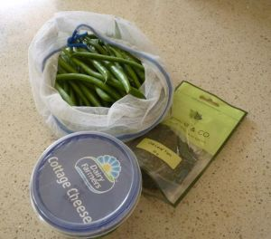 Green beans, dried dill leaves and a tub of cottage cheese