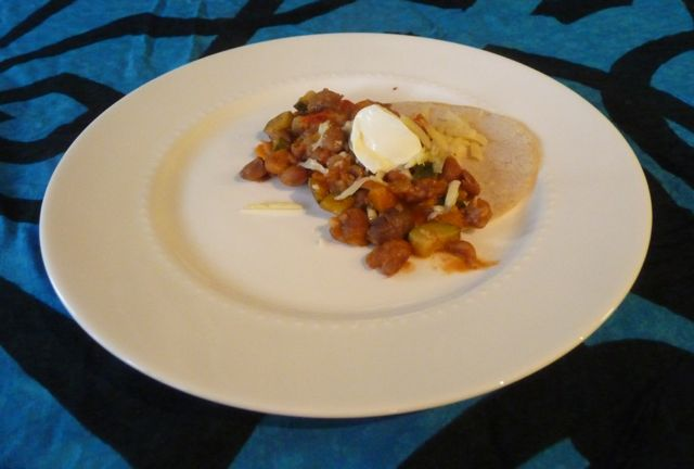 Tortilla with beans, cheese and sour cream